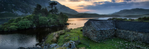 Panorama landscape sunrise over lake in mountains Stock Photography