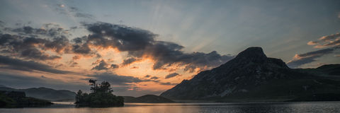 Panorama landscape sunrise over mountain lake Stock Photos