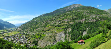 Panorama of landscape in Valais, Switzerland. Red roofed hut in the Alps of Valais, Switzerland stock photo