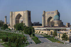 Panorama of large complex of Bibi-Khanym Mosque with the beautiful bright blue domes, rich mosaic decorations and old hieroglyphs. On its walls, Samarkand royalty free stock images
