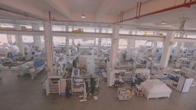 Panorama of a large modern machine-tool factory, a lot of people working in the factory.  stock video