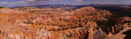 Panorama, late afternoon light colors the sandstone pinnacles Stock Photo