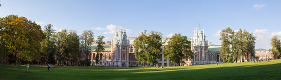 Panorama of lawn surrounded by trees in front of the Palace in the Park of Moscow. Autumn. Russia. Royalty Free Stock Images