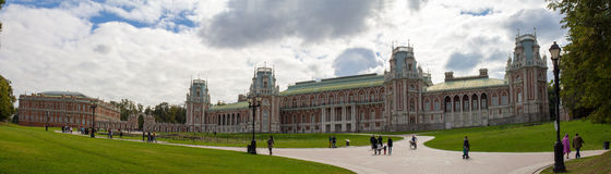 Panorama of lawn surrounded by trees in front of the Palace in the Park of Moscow. Autumn. Russia. Stock Photography