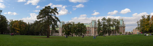 Panorama of lawn surrounded by trees in front of the Palace in the Park of Moscow. Autumn. Russia. Royalty Free Stock Photos