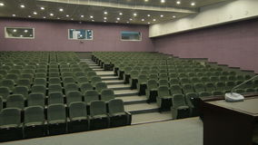 Panorama from Leather Chair to Microphone Table in Cinema Hall stock video