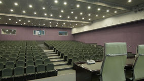 Panorama from Leather Chair to Microphone Table in Cinema Hall stock video footage