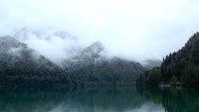 Panorama left-to-right Ritsa lake in the spring morning stock footage