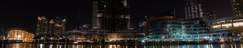 Panorama of lights on skyscrappers and buildings around lake in Royalty Free Stock Photos
