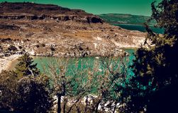 Panorama of Lindos bay from Acropolis.yachts are cruising arround. ACROPOLIS,LINDOS,RHODES/GREECE OCTOBER 26 2018 : panorama of Lindos bay from Acropolis.yachts royalty free stock image