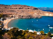 Panorama of Lindos bay from Acropolis.yachts are cruising arround. ACROPOLIS,LINDOS,RHODES/GREECE OCTOBER 26 2018 : panorama of Lindos bay from Acropolis.yachts stock photo
