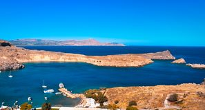 Panorama of Lindos bay from Acropolis.yachts are cruising arround. ACROPOLIS,LINDOS,RHODES/GREECE OCTOBER 26 2018 : panorama of Lindos bay from Acropolis.yachts royalty free stock photos