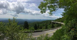 Panorama of Linn Cove Viaduct. The Linn Cove Viaduct, part of the Blue Ridge Parkway, hugs the side of Grand Father Mountain in the western corner of North royalty free stock photography