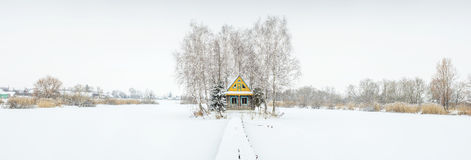 Panorama with little farm house in winter time Royalty Free Stock Photos