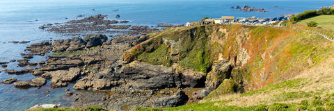 Panorama The Lizard peninsula Cornwall England UK south of Helston in summer on calm blue sea sky day Stock Photography