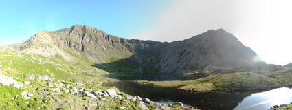 Panorama at Llyn-y-Gadair on cadair idris mountain in snowdonia Royalty Free Stock Photography