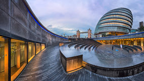 Panorama of London City Hall Building and Tower Bridge in the Mo. LONDON, UNITED KINGDOM - OCTOBER 7, 2014: London City Hall and Tower Bridge in London, UK. The Stock Photos