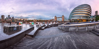 Panorama of London City Hall Building and Tower Bridge in the Mo Stock Image