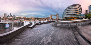 Panorama of London City Hall Building and Tower Bridge in the Mo. LONDON, UNITED KINGDOM - OCTOBER 7, 2014: London City Hall and Tower Bridge in London, UK. The Royalty Free Stock Photography
