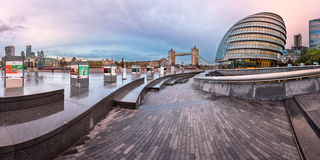 Panorama of London City Hall Building and Tower Bridge in the Mo. LONDON, UNITED KINGDOM - OCTOBER 7, 2014: London City Hall and Tower Bridge in London, UK. The Stock Image