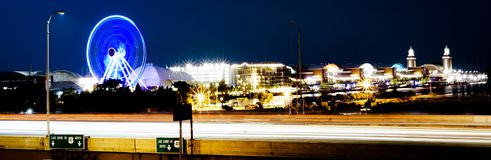 Navy Pier long exposure with highway as foreground at night. Panorama long exposure of navy pier at night Royalty Free Stock Images