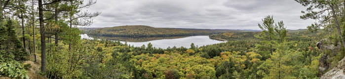 Panorama Looking Out Over a Lake Surrounded by Forest in Autumn. Algonquin Provincial Park, Ontario, Canada royalty free stock photo