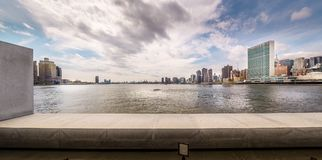East River and Manhattan royalty free stock images