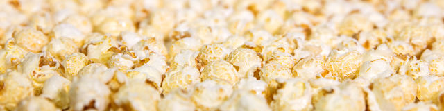 Panorama, lots of fresh popcorn background, concept funfair and Stock Photos
