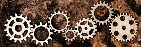 Panorama, lots of gears on rusty backgorund Stock Images