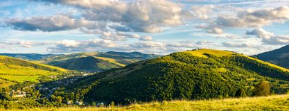 Calm and peaceful living in rural area. Panorama of lovely mountainous area in afternoon. gorgeous cloudscpe on the evening sky. calm and peaceful living in Royalty Free Stock Image
