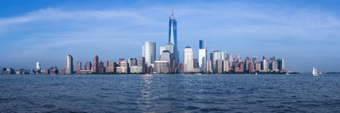 Panorama of Lower Manhattan at dusk. Panorama of lower Manhattan of New York City from Exchange Place at dusk with World Trade Center at full height of 1776 feet Stock Photo