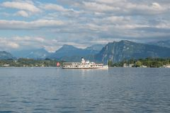 Panorama of Lucerne lake and mountains scene in Lucerne, Switzerland. Europe. Dramatic blue sky and sunny summer landscape stock images