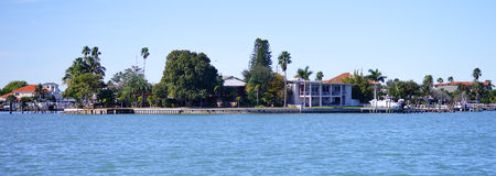 Panorama of a Luxury beach house with boat dock Royalty Free Stock Photo