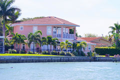 Panorama of Luxury beach house with boat dock Stock Photo