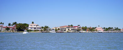 Panorama of Luxury beach house with boat dock Royalty Free Stock Photos