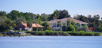Panorama of Luxury beach house with boat dock Royalty Free Stock Image