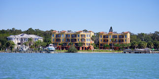 Panorama of Luxury beach house with boat dock Stock Photography