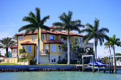 Panorama of Luxury beach house with boat dock Stock Photos