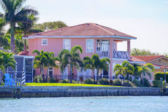 Panorama of Luxury beach house with boat dock Stock Image