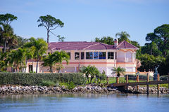 Panorama of Luxury beach house with ship dock Royalty Free Stock Photography