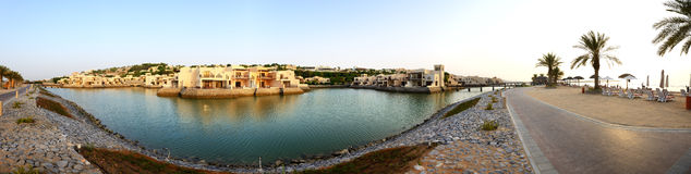 Panorama of the luxury hotel during sunset and beach. Ras Al Khaima, UAE Stock Photo