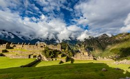 Panorama of Machu Picchu with dramatic sky and clouds stock photo