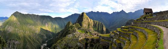 Panorama of Machu Picchu, lost Inca city in the. Panorama of Machu Picchu terraces, watcher's hut and Wuayna Picchu with shadow in early morning light. Machu Stock Photography