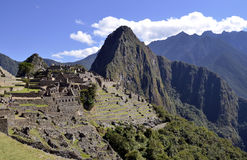 Panorama of Machu Pichu with Huayna Picchu. Rainforest jungle and mountains with blue sky in the background stock image