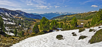 Panorama of Madriu-Perafita-Claror Valley in spring. Panorama from top of Madriu-Perafita-Claror Valley with forests, rivers and meadows in spring, snowy glacier Royalty Free Stock Image