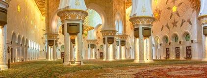 Panorama Main Prayer Hall. Abu Dhabi, UAE - April 22, 2013: panorama of the Main Prayer Hall in the Grand Mosque Sheikh Zayed, United Arab Emirates.The carpet is Royalty Free Stock Photos