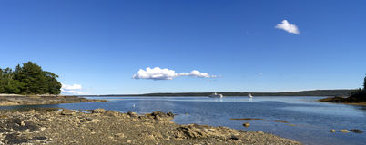 Panorama of Maine coast with yachts. A very wide view of the coast of Maine in Blue Hill with two large yachts in the distance Stock Photo