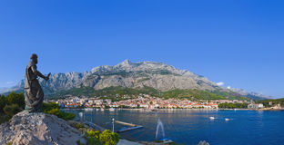 Panorama of Makarska and statue of St. Peter at Croatia Royalty Free Stock Images