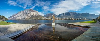 Panorama of Malgrate, Lecco, Italy. November 2017. A sculpture called eye of light royalty free stock image