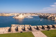 Panorama of the Maltese capital city Valletta. The Saluting Battery of La Valletta and Fort St. Angelo of La Vittoriosa in Malta Stock Photos